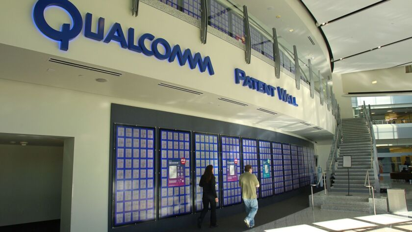 SAN DIEGO, CA -NOVEMBER 18, 2015 | Patents issued to Qualcomm are displayed on the Patent Wall at the Qualcomm headquarters in Sorrento Valley. | (K.C. Alfred/ San Diego Union-Tribune