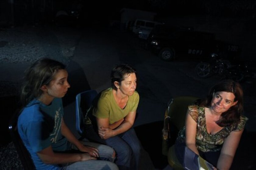 * American citizen Laura Silsby, 40, of Boise, Idaho, right, speaks as Nicole Lankford, 18, of Middleton, Idaho, left, and Carla Thompson, 53, of Meridien, Idaho, center, look on during an interview with the Associated Press at police headquarters at the international airport in Port-au-Prince, Saturday, Jan. 30, 2010. Ten Americans were detained by Haitian police on Saturday as they tried to bus 33 children across the border into the Dominican Republic, allegedly without proper documents. (AP Photo/Ramon Espinosa)