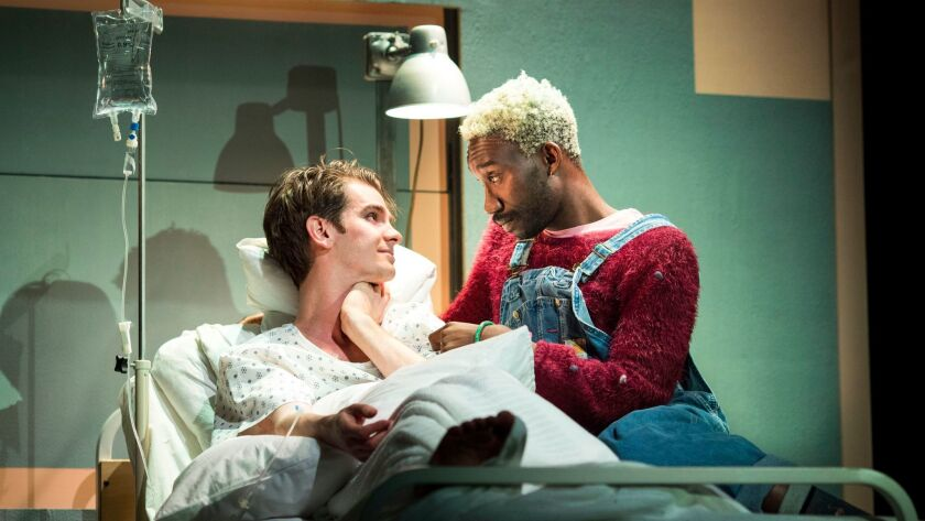 "Andrew Garfield, left, and Nathan Stewart-Jarrett in ""Angels in America — Millennium Approaches."""