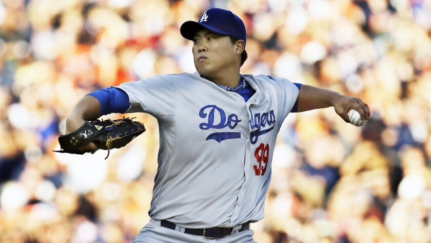 Dodgers starter Hyun-Jin Ryu delivers a pitch during the first inning of the team's 14-5 road loss to the Detroit Tigers on Tuesday.