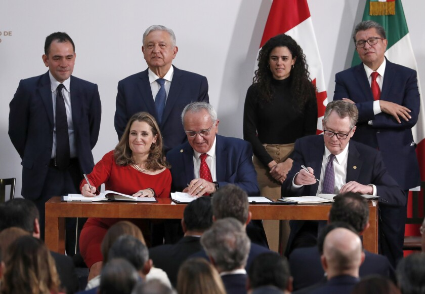 Deputy Prime Minister of Canada Chrystia Freeland, Mexico's top trade negotiator Jesus Seade, and U.S. Trade Representative Robert Lighthizer, sign an update to the North American Free Trade Agreement
