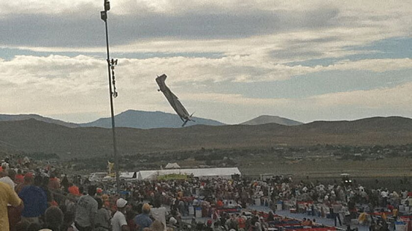 A P-51 Mustang airplane plummets toward spectators at the National Championship Air Races in Reno on Sept. 16, 2011. The pilot and 10 people on the ground were killed.