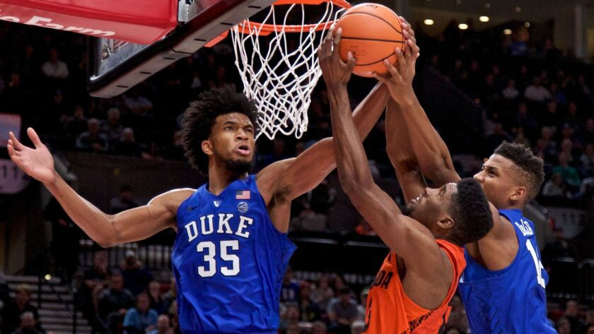 Duke forwards Marvin Bagley III (35) and Javin DeLaurier battle Florida forward Kevarrius Hayes for a rebound during the second half Sunday.