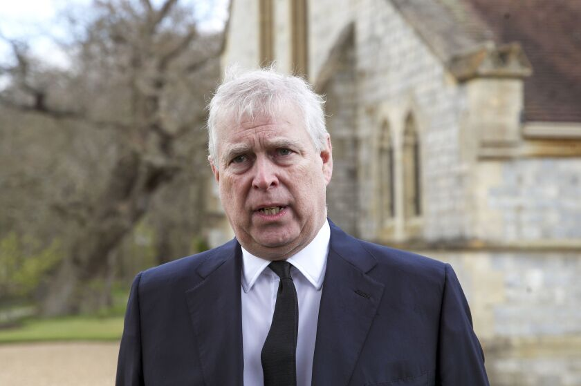 FILE - In this Sunday, April 11, 2021 file photo, Britain's Prince Andrew speaks. during a television interview at the Royal Chapel of All Saints at Royal Lodge, Windsor, England, Sunday, April 11, 2021. A U.S. court will hold a pretrial conference Monday, Sept. 13, 2021 in the civil suit filed by a woman who claims Prince Andrew sexually assaulted her as the two sides argue over whether the prince has been properly served with documents in the case. Attorneys for Virginia Giuffre say the documents were handed over to a Metropolitan Police officer on duty at the main gates of Andrew's home in Windsor Great Park on Aug. 27. (Steve Parsons/Pool Photo via AP, File)
