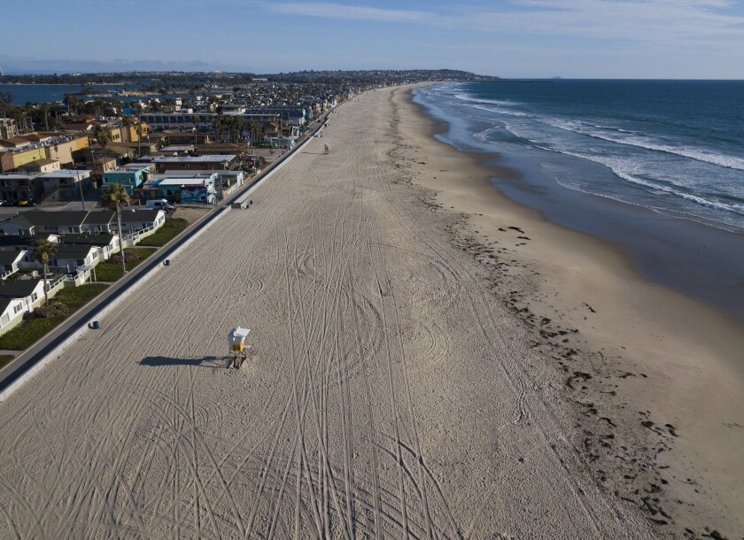 An empty Pacific Beach on March 24, 2020. San Diego city beaches, parks and trails were closed to slow down the spread of the coronavirus. Tax revenue lost because of shutdown orders has San Diego facing a $250 million budget gap.