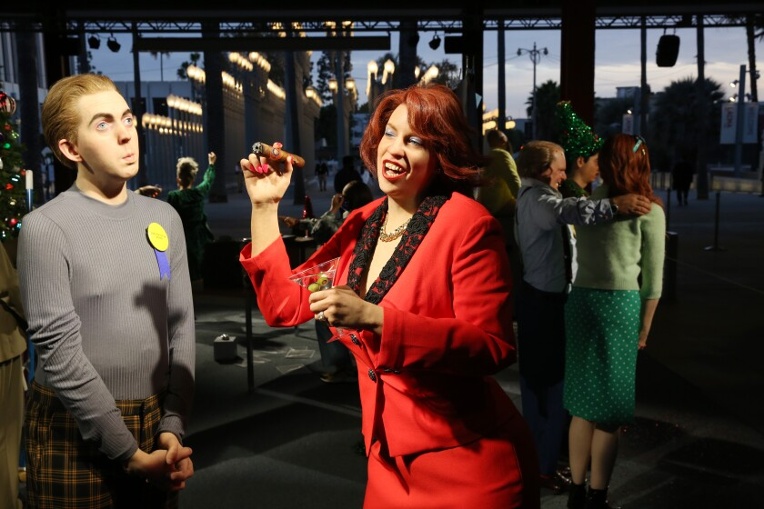 """A CEO and an employee of the month in Alex Prager's sculptural installation, """"Farewell, Work Holiday Parties."""""""