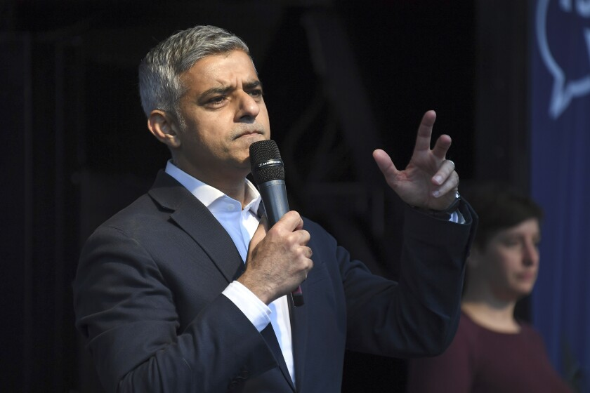 FILE - In this Saturday, Oct. 19, 2019 file photo, London mayor Sadiq Khan addresses pro and anti-Brexit supporters in London. London's mayor has called for an investigation after rapper Wretch 32 released a video on Tuesday June 9, 2020, of his father being tasered by a police officer. (AP Photo/Alberto Pezzali, File)