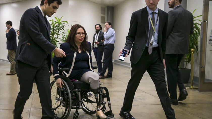 U.S. Sen. Tammy Duckworth (D-Ill.) speaks with reporters as she arrives for a weekly policy luncheon on Dec. 12, 2017, in Washington, D.C. She has pushed for legislation to require airlines to report data on lost or damaged wheelchairs and mobility scooters.