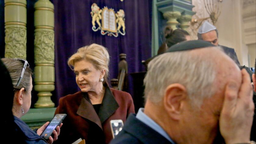 Rep. Carolyn Maloney, center, a New York Democrat and member of Congress' bipartisan task force on a