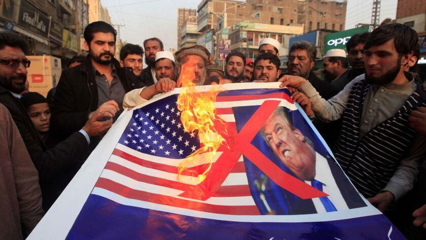 Pakistani traders protest against U.S. President Donald Trump in Peshawar, Pakistan, Friday, Jan 5,