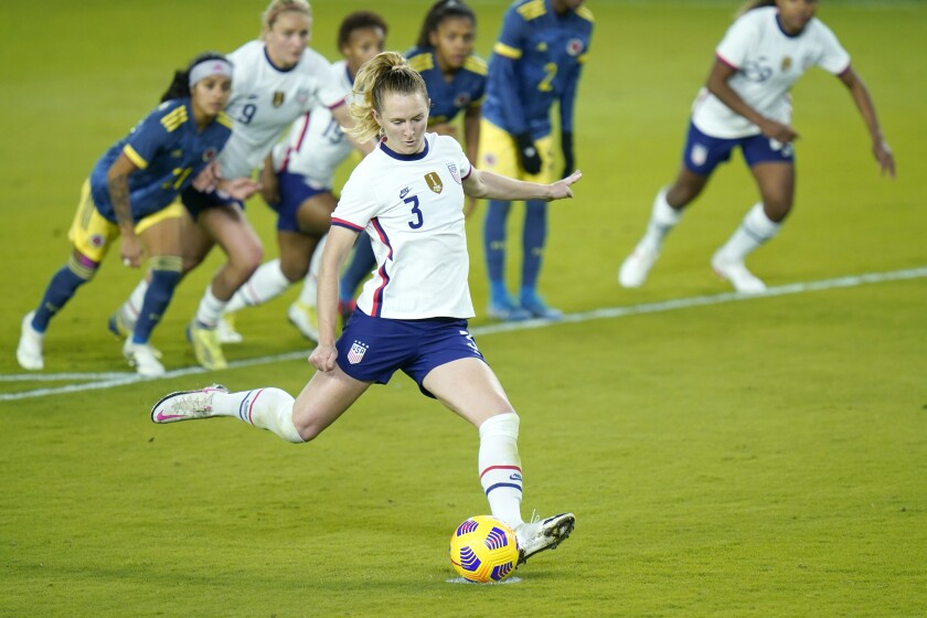 United States midfielder Samantha Mewis (3) scores a goal on a penalty kick during the second half of an international friendly soccer match against Colombia, Monday, Jan. 18, 2021, in Orlando, Fla. (AP Photo/John Raoux)