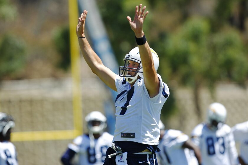 Chargers Philip Rivers tries to block a pass during a mini camp practice.