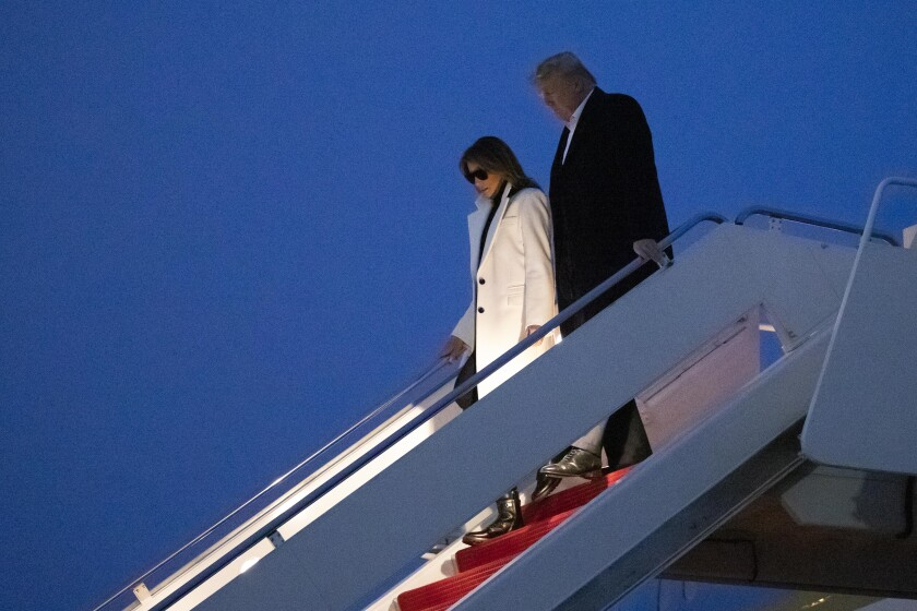 President Trump and First Lady Melania Trump depart Air Force One after arriving Wednesday at Andrews Air Force Base.