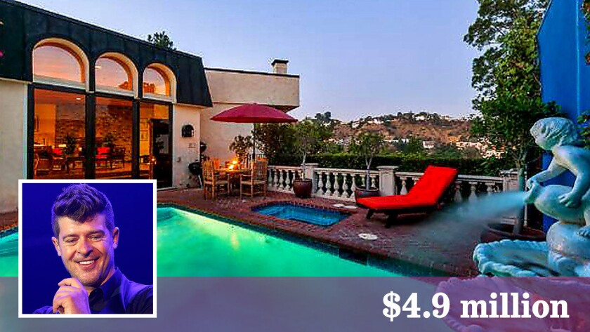 Robin Thicke has sold a house in Hollywood Hills for $4.9 million.