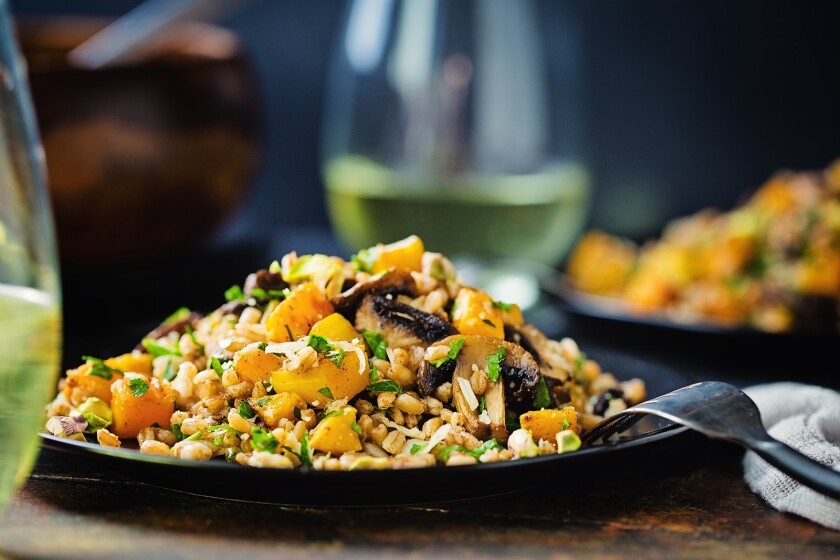 Warm farro salad with roasted mushrooms and butternut squash is a hearty yet healthy vegetarian meal.