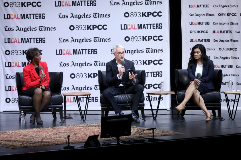 Los Angeles Dist. Atty. Jackie Lacey, left, and challengers former San Francisco D.A. George Gascón and former public defender Rachel Rossi attend a debate at the Aratani Theatre at the Japanese American Cultural & Community Center in Los Angeles on Jan. 29.