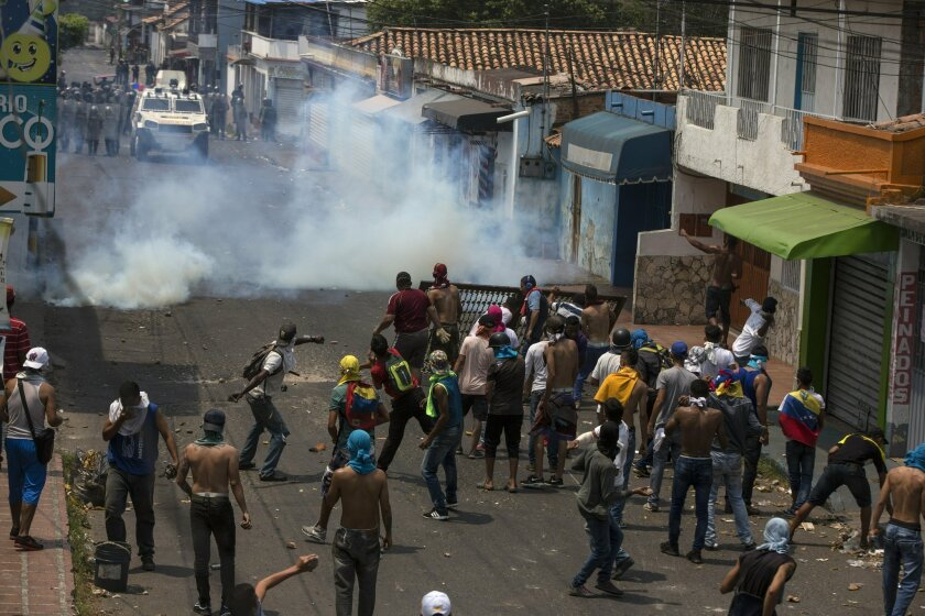 Demonstrators clash with the Bolivarian National Guard in Urena, Venezuela, near the border with Colombia, Saturday, Feb. 23, 2019.