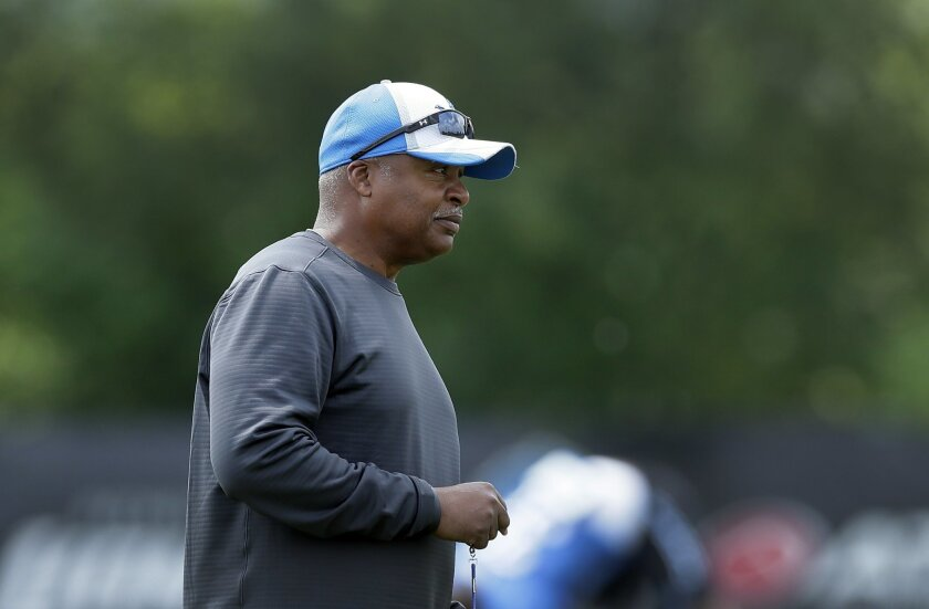 Detroit Lions head coach Jim Caldwell watches practice during an NFL football training camp in Allen Park, Mich., Thursday, July 31, 2014. Caldwell has had a calming presence on his new team, perhaps giving the franchise what it needed after five years with the emotionally charged Jim Schwartz. (AP Photo/Carlos Osorio)