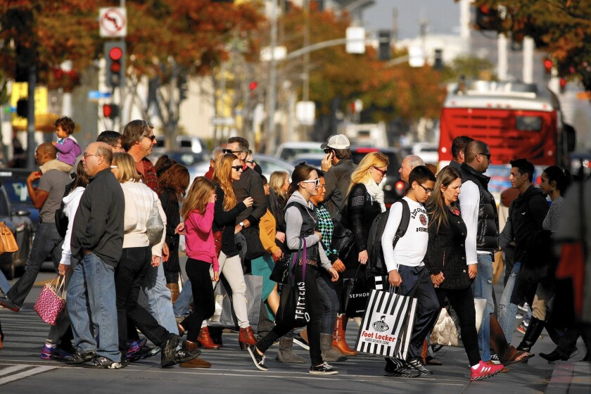 Shoppers brave the Third Street Promenade in Santa Monica on the last Saturday before Christmas, known as Super Saturday, in 2013.