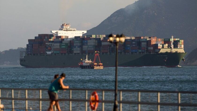 A containership sails through Hong Kong's West Lamma Channel on Sept. 18.