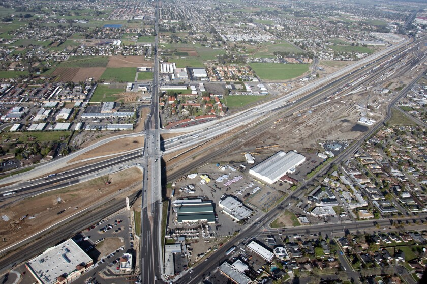 California's bullet train project has struggled to acquire all the parcels it needs for high-speed rail, a project that involves relocating numerous utilities and roads. This aerial photo shows the realignment of Highway 99 in Fresno in March 2018.