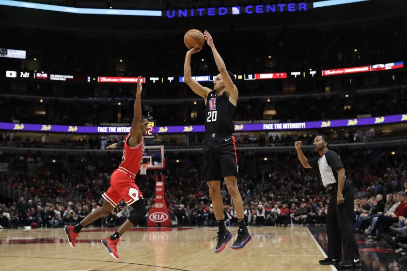 Clippers guard Landry Shamet shoots over Bulls forward Kris Dunn during the first half of a game Dec. 14.