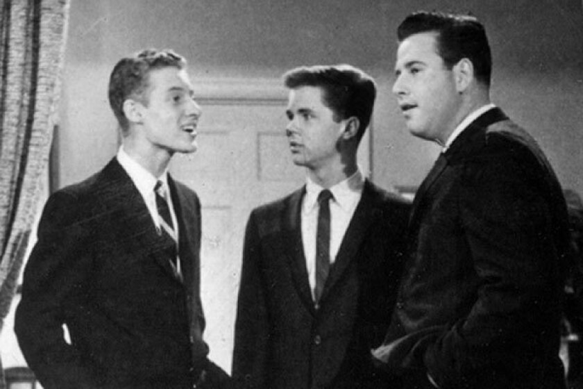 """Ken Osmond, left, Tony Dow and Frank Bank starred in TV's """"Leave It To Beaver."""""""
