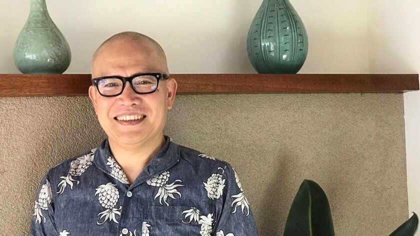 Lunar New Year stamp artist Kam Mak, when he was in Honolulu last year. Chinese American artist Kam