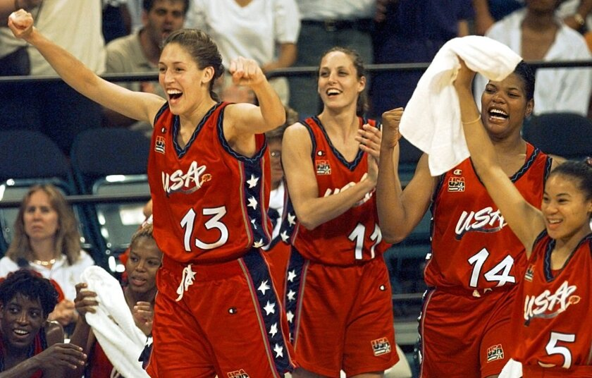 FILE - In this July 27, 1996, file photo, USA's Rebecca Lobo (13) leads the team off the bench to cheer at the end of their 96-79 victory over Australia in women's Olympic basketball at the Georgia Dome in Atlanta. From left are Lobo, Katy Steding (11), Venus Lacey (14), and Dawn Staley (5). (AP Photo/Elise Amendola, File)