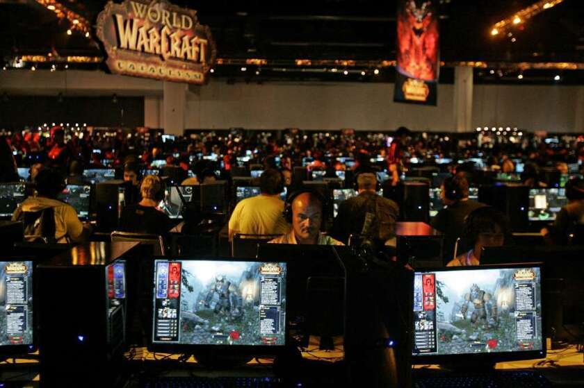A couple described as obsessed with the World of Warcraft online game were sentenced to prison for neglecting two young girls in their care. Above, a World of Warcraft game area at a convention in Anaheim in 2009.
