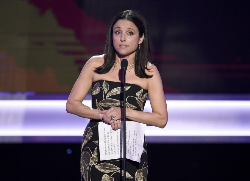 """Julia Louis-Dreyfus accepts the award for female actor in a comedy series for """"Veep"""" at the 23rd Screen Actors Guild Awards at the Shrine Auditorium on Sunday in Los Angeles."""