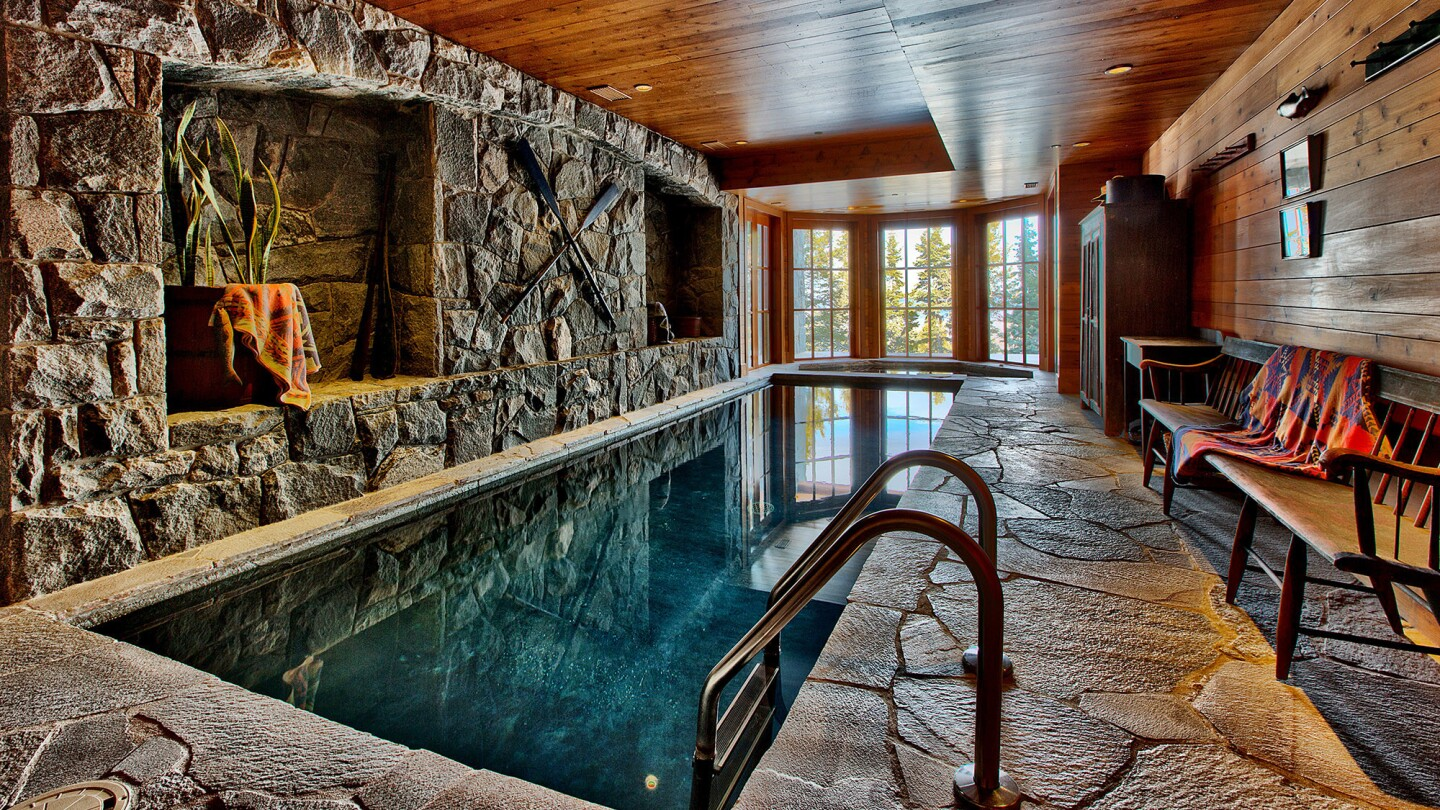The 14,100-square-foot house features a two-story living room, an indoor swimming pool and a game room.