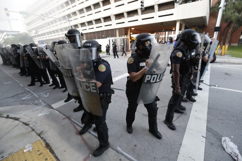 Police in Miami stand in formation during a protest on May 30.