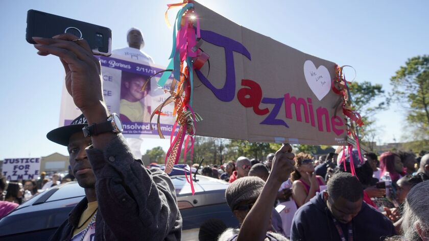 People rally on East Sam Houston Parkway in Houston in memory of Jazmine Barnes.