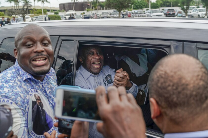 Former Ivorian president Laurent Gbagbo arrives at the international airport, in Abidjan, Ivory Coast, Thursday, June 17, 2021. After nearly a decade, Gbagbo returns to his country following his acquittal on war crimes charges was upheld at the International Criminal Court earlier this year. (AP Photo/Leo Correa)