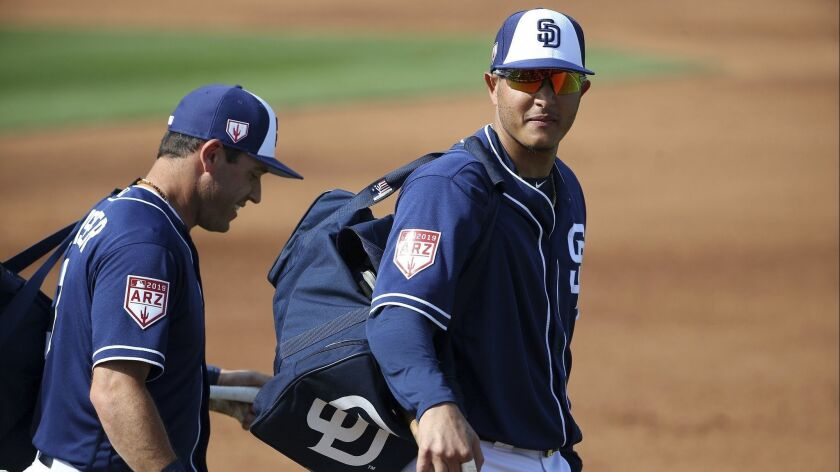 San Diego Padres' Manny Machado, right, and Ian Kinsler, left, walk off the field prior to the sixth