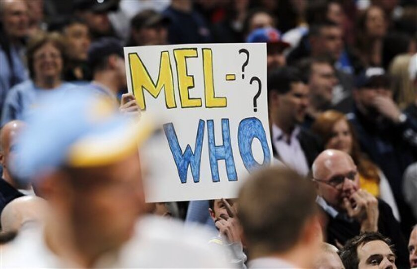 Denver Nuggets fan holds up a sign during introductions directed at New York Knicks forward Carmelo Anthony before an NBA basketball game in Denver, Wednesday, March 13, 2013. The game marked Anthony's first at the Pepsi Center after his trade from Denver to New York two years ago. (AP Photo/David Zalubowski)