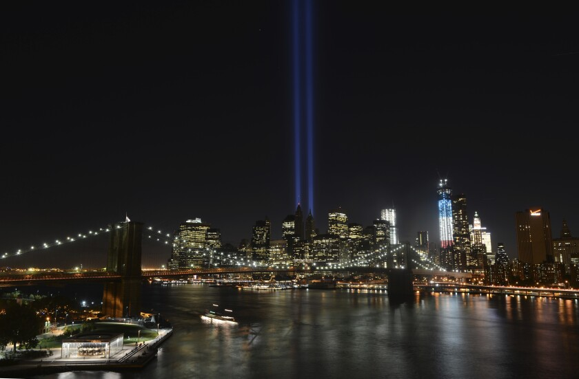 FILE - In this Sept. 11, 2012 file photo, The Tribute in Light lights up lower Manhattan in New York. Plans are back on to beam twin columns of light into the Manhattan sky to represent the World Trade Center during next month's anniversary of the 9/11 terror attacks. The Tunnel to Towers Foundation announced Friday, Aug. 14, 2020, that it is working on plans to shine the twin beams during its alternative 9/11 ceremony. (AP Photo/Henny Ray Abrams, File)