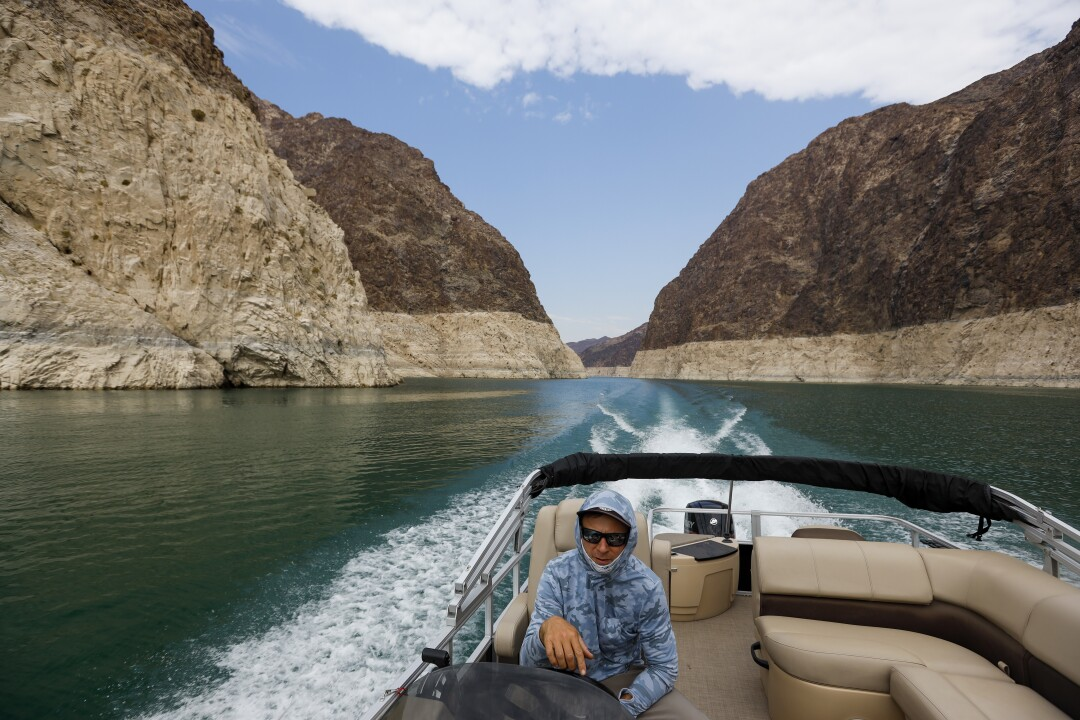 Eric Richins pilots a boat on Lake Mead