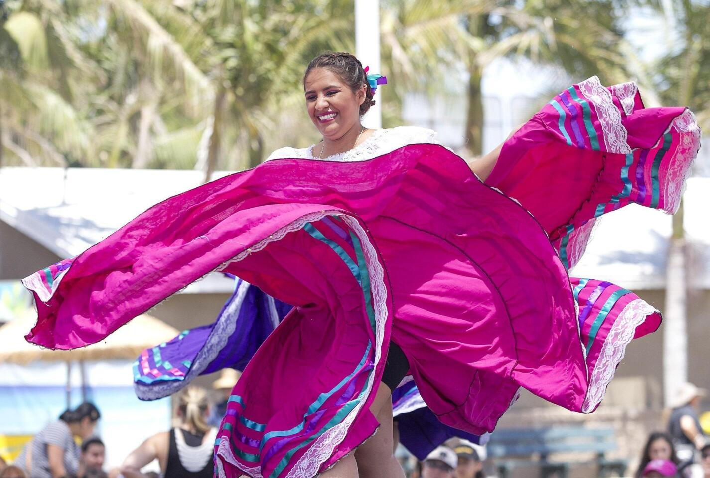 Dallana Salinas performs a traditional ballet folklorico dance during a Save Our Youth musical performance on the Heritage Stage at the Orange County Fair on Wednesday.