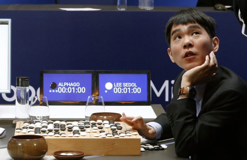 Google DeepMind's AI program AlphaGo is pictured along with South Korean Go master Lee Sedol in March 2016.