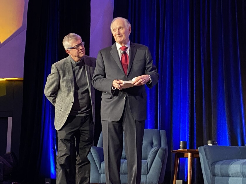 Jamie Williamson (left), Scripps Research's executive VP of research and academic affairs, jokes around with Alan Alda before the actor takes questions from the audience.