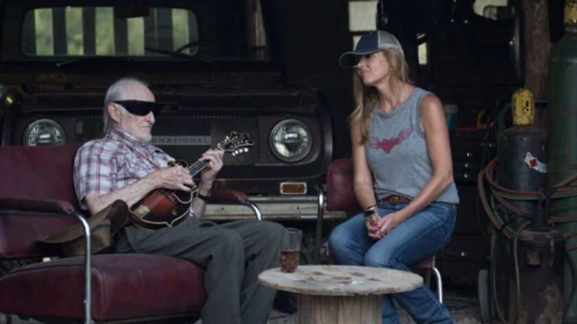 """Jesse McReynolds and Connie Britton in a scene from """"Nashville."""""""