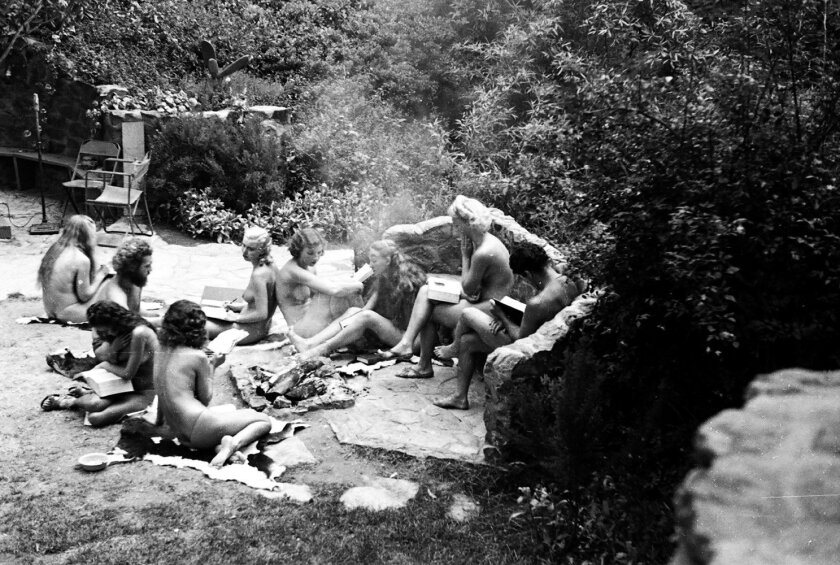 Members of the nudist colony at Zoro Gardens in Balboa Park in 1935-36 sat around reading, played volleyball and entertained onlookers.