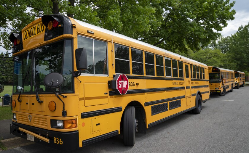 School buses parked in Falls Church, Va. Few Americans believe schools should return to normal this fall, a poll says.