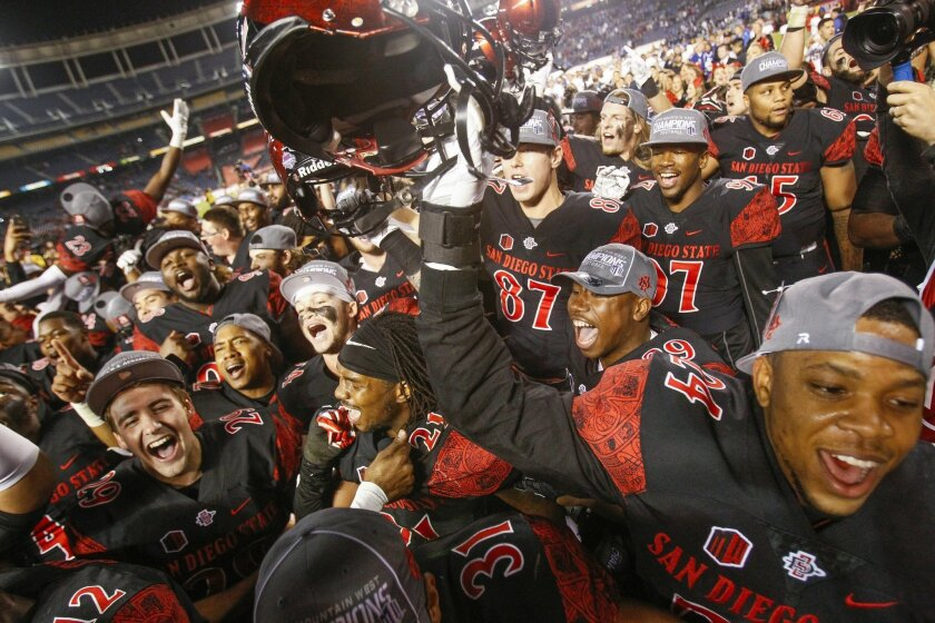 The Aztecs celebrate their 27-24 win over Air Force to win the Mountain West conference championship at Qualcomm Stadium.