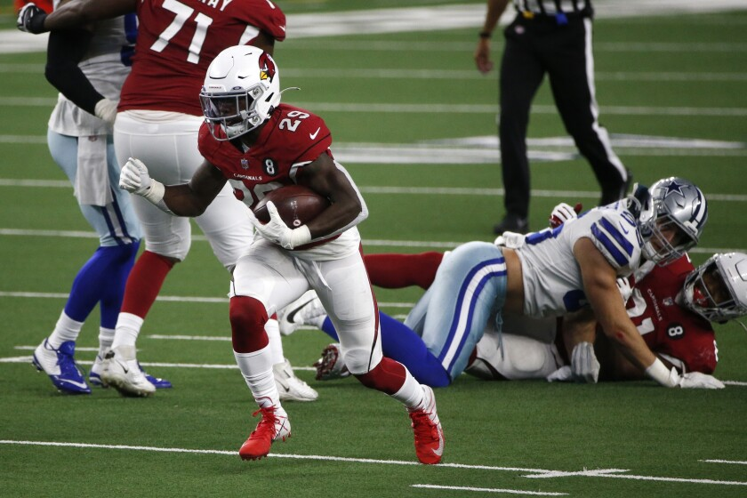 Arizona Cardinals running back Chase Edmonds (29) breaks through the line for a short gain in the second half of an NFL football game against the Dallas Cowboys in Arlington, Texas, Monday, Oct. 19, 2020. (AP Photo/Michael Ainsworth)