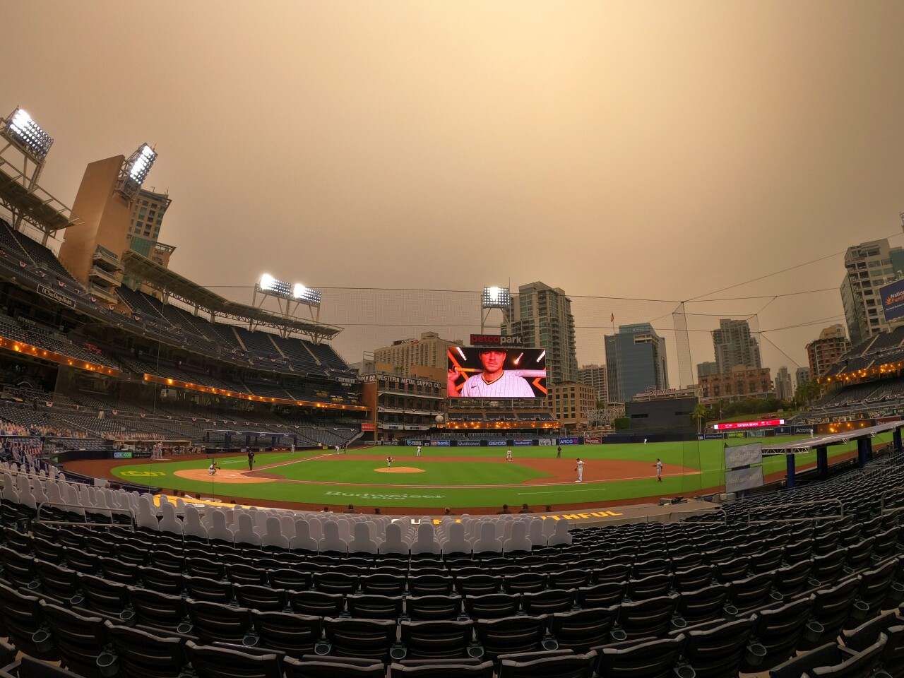 The sun sets as the San Diego Padres and San Francisco Giants