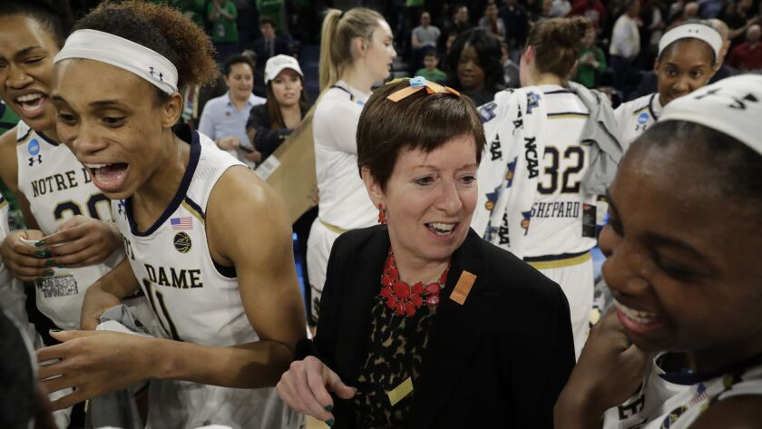 Notre Dame head coach Muffet McGraw celebrates with her team after defeating Stanford 84-68 in a reg