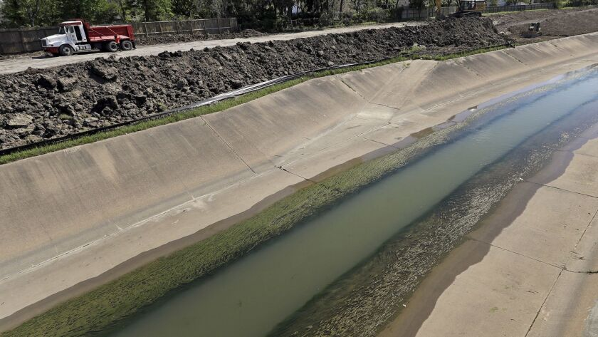 Workers excavate and widen Brays Bayou in Houston last week as part of a nearly $500-million flood-control project.
